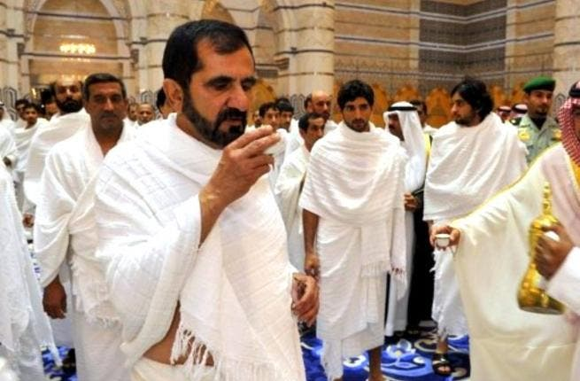 Saudi-meets UAE: Dubai's ruler and UAE Vice President Sheikh Mohammed bin Rashed al-Maktoum, wearing white robes, is offered traditional sour coffee in the Red Sea port city of Jeddah, before he reaches his destination at the holy city of Mecca where he will perform Umrah just before Eid.