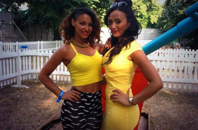 Amelle Berrabah (L) sportin' her outfit that was not sunlight proof! (Image: Twitter)