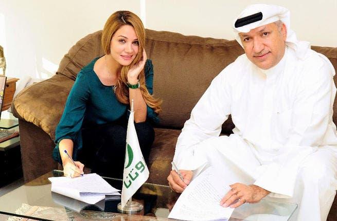 Diana Haddad signs the big contract! (Image: Facebook)