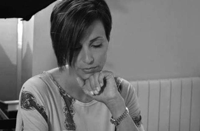 Farah is one sad daughter as she says goodbye to her deceased dad. (Image: Facebook)