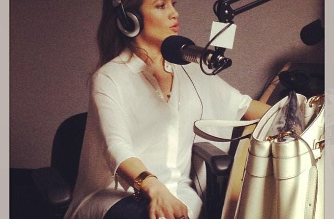 Jennifer Lopez talking on the mic (Photo courtesy of Facebook)