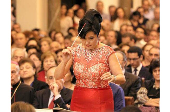 Joana Nachef conducts and looks good doing it. Why not? (Image courtesy of now.mmedia.me)