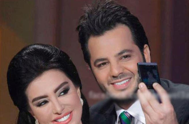 Maisa Moghrabi poses with talk-show host Nishan in happier times at Doha Tribeca film festival