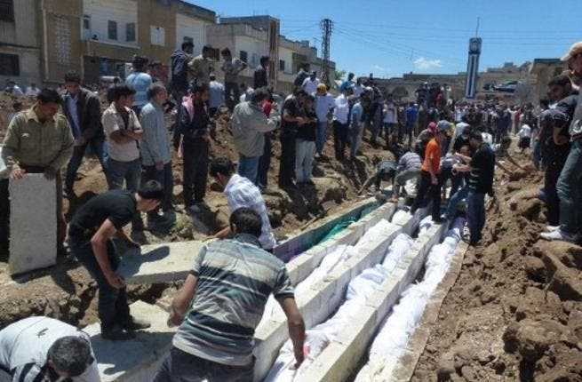Mass burial at Houla, Syria