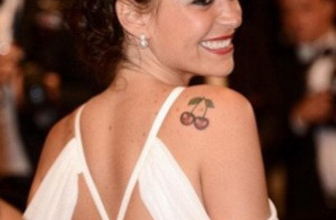 Menna Shalabi sports her cherry slip-shoulder tattoo