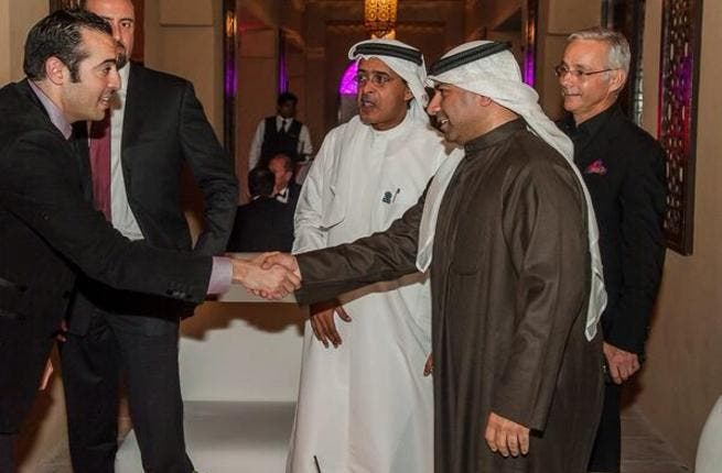 Mohammad al-Turki shaking hands at DIFF (Image: Twitter)