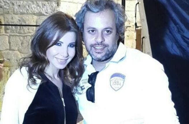 Behind the scenes of Nancy's new music video with her director. (Image: Twitter)