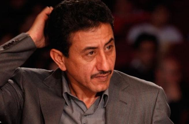 Nasser al Qasabi scratches his head, deciding to buzz or not to buzz!