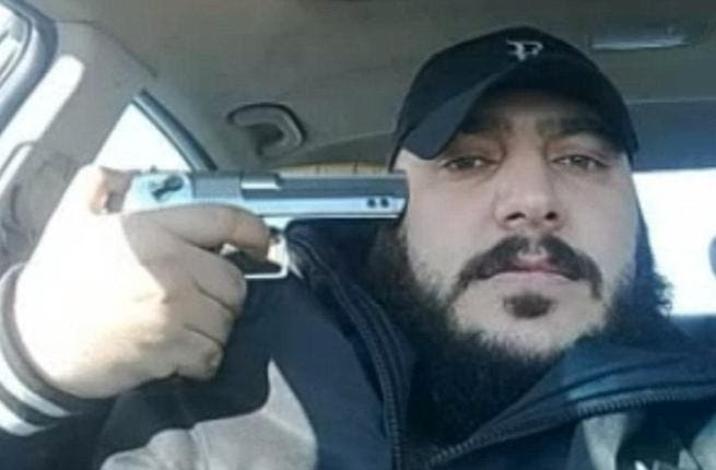 One member of the Shabiha posing with his gun - source The Daily Mail