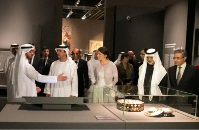 Shaikh Hazza Bin Zayed and other guests look at some of the Louvre's permanent pieces during the 'Birth of a Museum' exhibition.