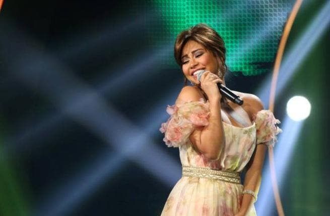 Get it, Girl! The screen LOVES Sherine! (Photo from Arab Idol Facebook page)