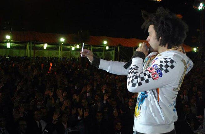 Abd Elfattah Grini greets his audience in Alexandria (Image: Facebook)