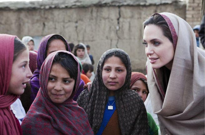 Angelina Jolie poses with school girls in Afghanistan