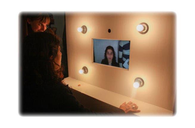 Lady tries photo-booth installation at Medrar Gallery, Friday 22 February. Photo: Mostafa Sheshtawy