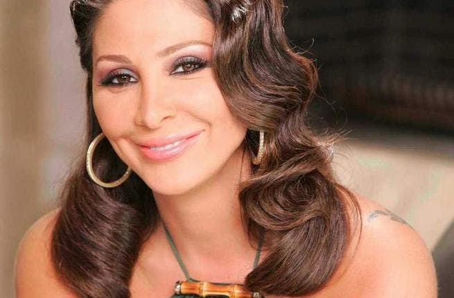 Elissa smiles with happiness