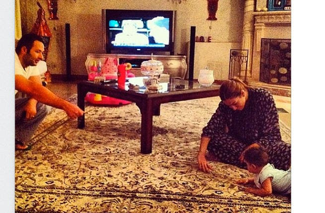 Here's the pic Ghada Tweeted of granddaughter learning to crawl (Image: Twitter)