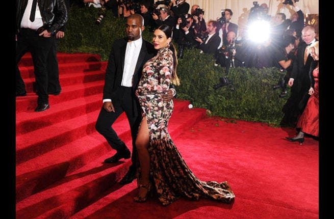 Kim Kardashian and Kanye West (below prior to the birth of their child) want their destination wedding in Egypt, says the celebrity rumor mill (Photo by Dimitrios Kambouris/Getty Images)