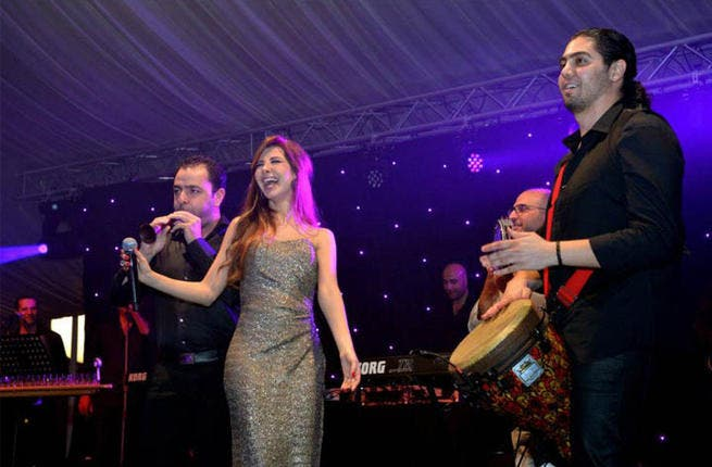 Nancy Ajram doesn't hold back and lets out what it's like to be an AI judge, singing star, and a mama.