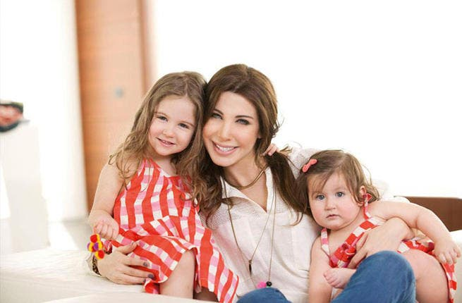 Nancy Ajram takes time out for hugs and kisses with her sweet daughters Milla and Ella