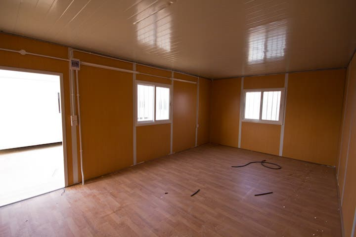 Inside one of the cabins that will hold one family