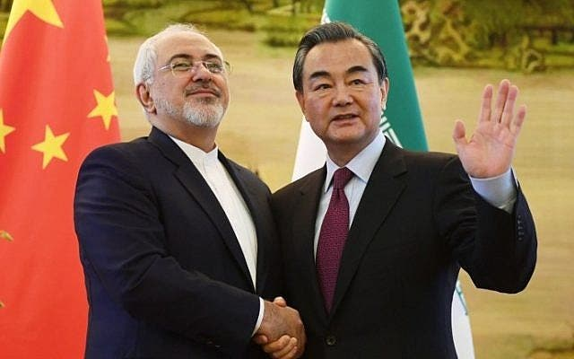 Iran's Foreign Minister Mohammad Javad Zarif (L) shakes hands with his Chinese counterpart Wang Yi. (AFP/ File)