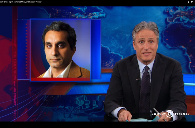 Photo taken from a Daily Show broadcast in which Jon Stewart defends Bassem Youssef from charges against insulting president Morsi and religion. (Albawaba)
