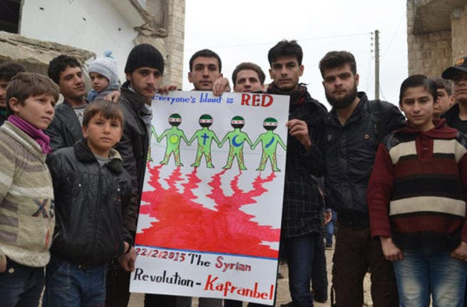 While Syrian opposition fighters are accused of stirring sectarianism, these Syrians have been busy trying to prove that not everyone feels the same. As the sign says, Christian or Muslim blood is still blood.