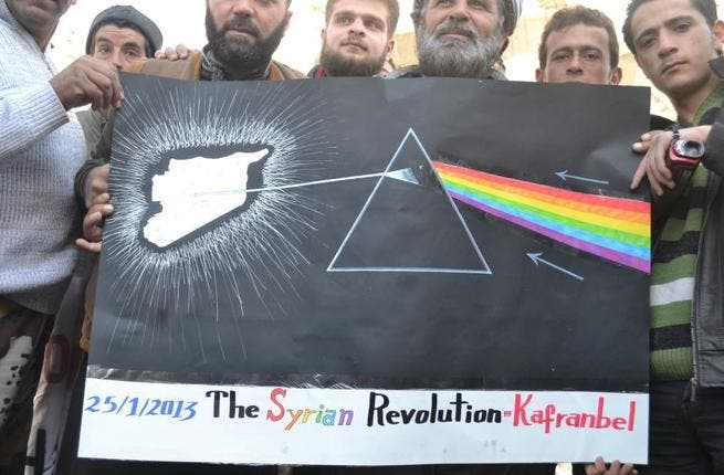 Nothing says 'revolution' like a Pink Floyd cover poster and a multi-colored, multi-faceted message from the heart of Syria said it all. A rainbow prism beaming light on the troubled country came from abroad, not inside, the nation.