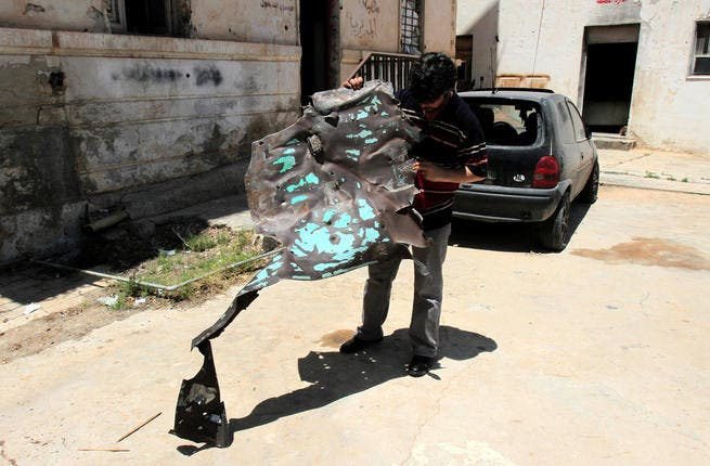 A Libyan man inpects one of the two police stations that were attacked on May 10, 2013 in the eastern Libyan city of Benghazi. Bomb attacks targeted two police stations in Benghazi causing extensive material damage but no casualties, a security official said. (Abdullah Doha/ AFP)