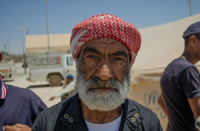 The weathered face tells a thousand words of suffering: Mohammad Qassam al-Lubad arrived at Zaatari at midnight on May 11 after fleeing Sanamayn, a Syrian village near the small but pivotal city of Daraa, just north of the border with Jordan. (AlBawaba/J. Zach Hollo)