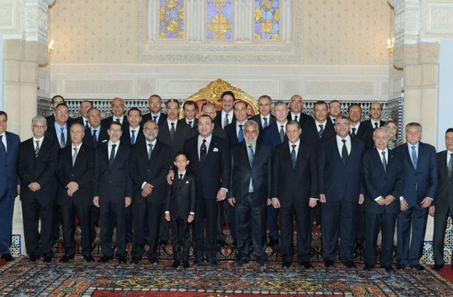 A picture taken at the royal palace in Rabat shows Moroccan King Mohammed VI (first row C) and crown prince Moulay Hassan posing for a family picture of the new government led by moderate Islamist Prime Minister Abdelilah Benkirane. (AFP/Azzouz Boukallouch)