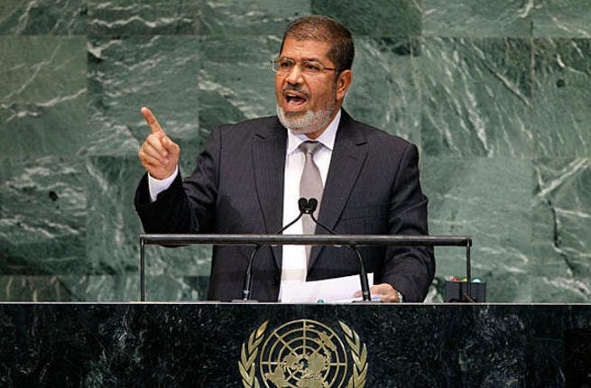 """Giving opponents the finger must have seemed like a good idea at the time but Egyptians took to social media sites in their hoards to mock Morsi for his finger wagging speech. After all, this was the man who threatened to """"cut off any finger"""" that meddled in his affairs."""
