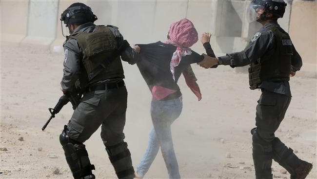 Israeli forces detain a Palestinian protester during a rally by college students near Ramallah against the incarceration of Palestinian students in the West Bank village of Betunia, outside the Israeli-run Ofer prison, March 10, 2015. (AFP/File)