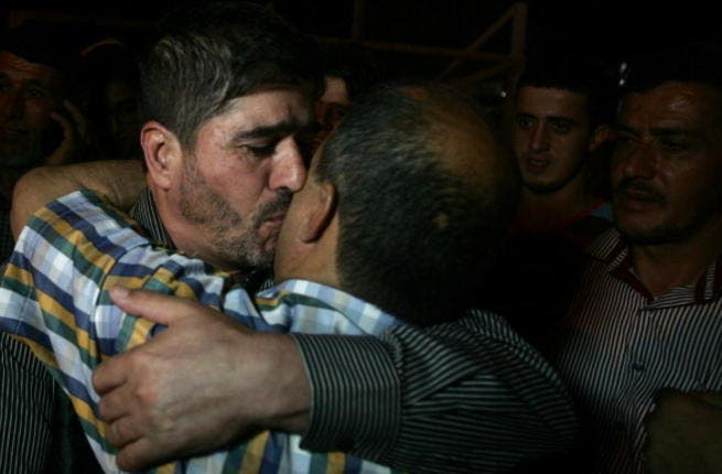 One of the Palestinian leaders of the Islamic Jihad movement in the West Bank, Jaafar Ezzeddine embraces a relative after being release from an Israeli prison in the West Bank city of Jalama, near Jenin, on May 8, 2013. (SAIF DAHLAH/AFP/Getty Images)