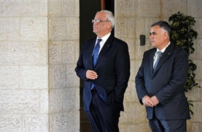 Chief Palesinian negotiator Saeeb Erakat (L) and one of his deputy wait for US Secretary of State John Kerry before his meeting with Palestinian President Mahmud Abbas on July 19, 2013 at the Mukataa compound, in the West Bank city of Ramallah. Kerry flew by helicopter to the West Bank from Jordan to meet Abbas as he battled to salvage his Middle East peace bid.( FADI AROURI/AFP/Getty Images)