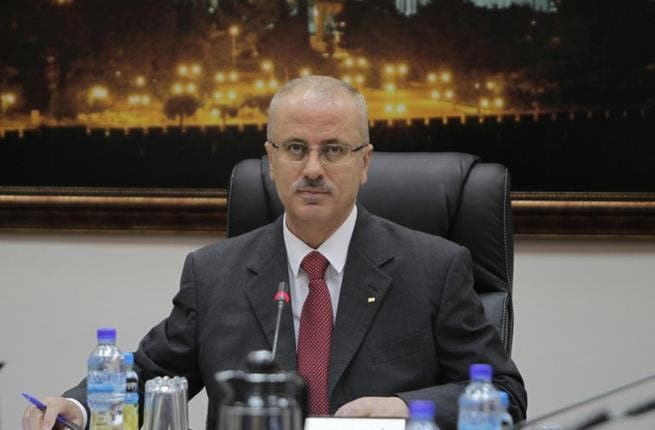 President Abbas has formally accepted the resignation of newly appointed PM Rami Hamdallah (file AFP)