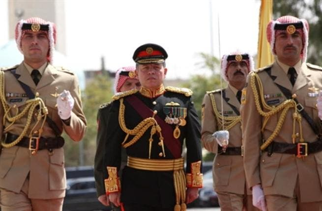 JORDAN, Amman : In a handout picture released by the Jordanian Royal Palace, Jordan's King Abdullah II marches with an honour guard to open the autumn session of the Jordanian parliament in the capital Amman on October 5, 2008