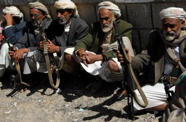 Elderly Yemeni tribesmen sit holding their weapons during a tribal ceremony in Khamer city, Amran governorate, 75 km north of the Yemeni capital Sanaa on January 22, 2008