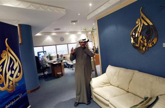 Al-Jazeera's bureau chief in Kuwait Saad al-Saedi talks on his mobile phone at the channel's office in Kuwait City on December 13, 2010