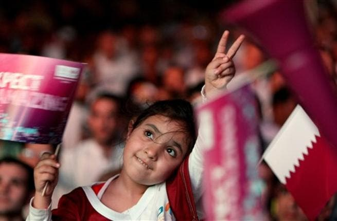 A Qatari girl celebrates in Doha after the tiny Gulf state was chosen to host the 2022 World Cup on December 2, 2010