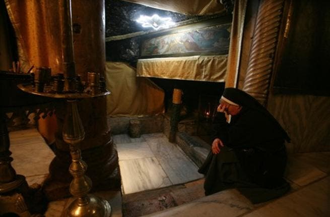 A nun prays at the Church of the Nativity, believed to be the birthplace of Jesus Christ, in the West Bank town of Bethlehem on December 24, 2010 as the Holy Land prepares to mark Christmas