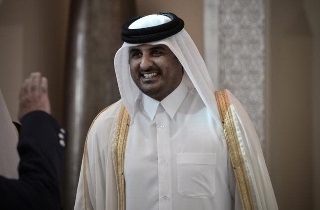 Former Qatari Crown Prince Sheikh Tamim bin Hamad al-Thani smiling as he arrives in the Bahraini capital of Manama, to attend the annual Gulf Cooperation Council (GCC) summit (Mohammed Al-Shaikh / AFP)