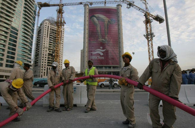 World Cup workers in Qatar are made to work for 12 hours at a time without a break.  They are not fed for entire days and denied access to drinking water. (Image credit: AFP)