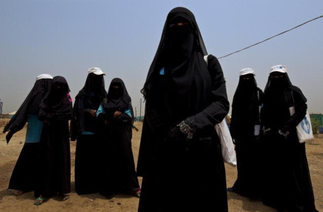 Shrouded in black, are these women the last of an ending era? - Shown for illustrative purposes.