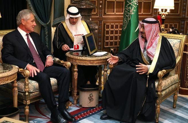 U.S. Secretary of Defense Chuck Hagel meets with Saudi Crown Prince Salman bin Abdulaziz while Ambassador Adel Al-Jabeir listens, on December 9, 2013 in Riyadh. [AFP]