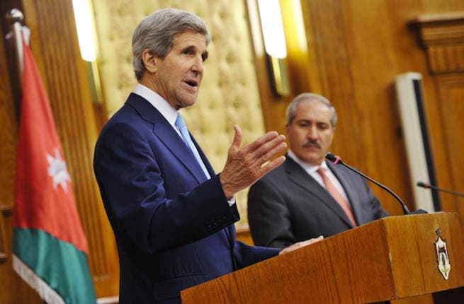 US Secretary of State John Kerry speaks during a joint press conference in Amman as Jordan's Foreign Minister Nasser Judehlooks on (Source: AFP PHOTO/Mandel NGAN-POOL)