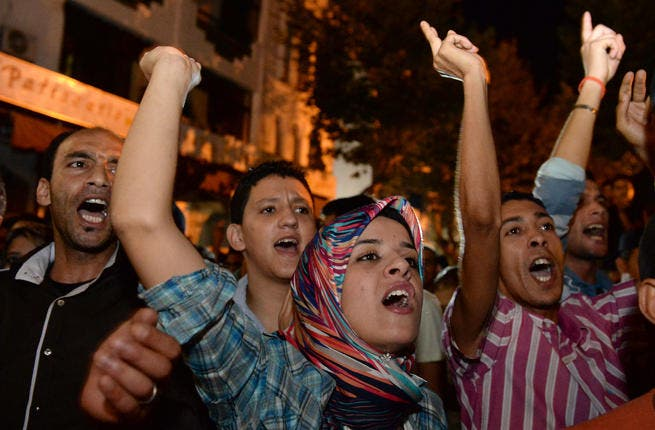 Protestors chant slogans during a demonstration on in Kenitra against the pardon by King Mohamed VI of Morocco of a Spanish pedophile (AFP/FADEL SENNA)