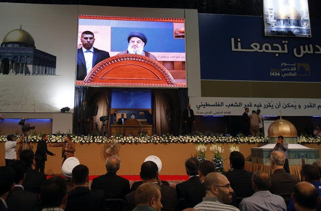 A general view shows Hezbollah's chief Hassan Nasrallah delivering a speech during a rare public appearance at a gathering to mark the