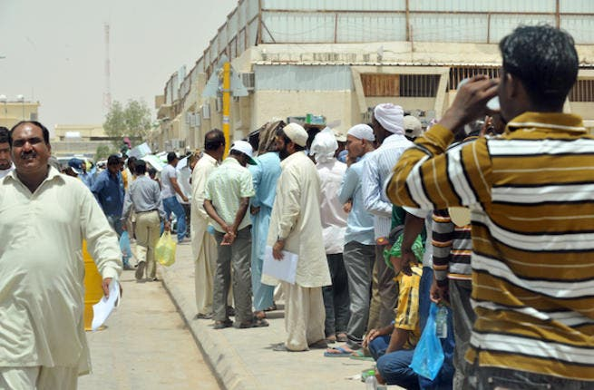 Expatriates wait to correct work documents outside the Saudi Labour Ministry (Source: AFP file photo)