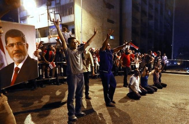 Supporters of the Muslim Brotherhood and Egypt's ousted President Mohamed Morsi block the Six October bridge on July 16, 2013 in the center of Cairo. (Source: AFP/MARWAN NAAMANI)
